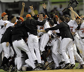 The Netherlands celebrates on the field after it upset the Dominican Republic on Tuesday, winning, 2-1, and moving to the next round. (Andres Leighton/AP)
